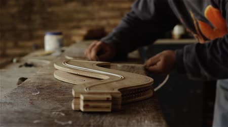 Artisan Building A Wooden Musical Instrument.