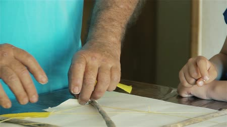 Father Making Kite Together with His Son. Stock mozgókép