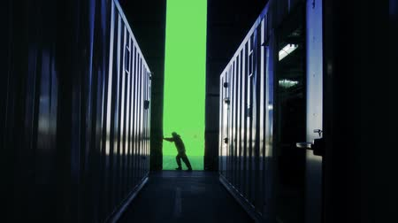 Man Opening Door Of A Container Warehouse With Green Screen Background. Stock mozgókép