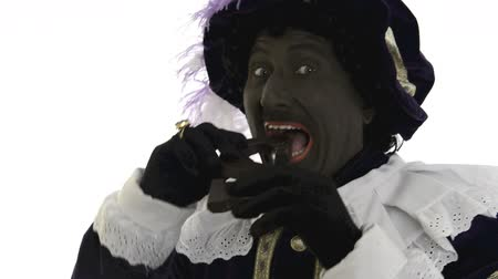 expressed : Zwarte Piet is eating a chocolate letter Stock Footage