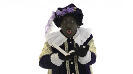 garip : Zwarte Piet is reading in the book of Sinterklaas