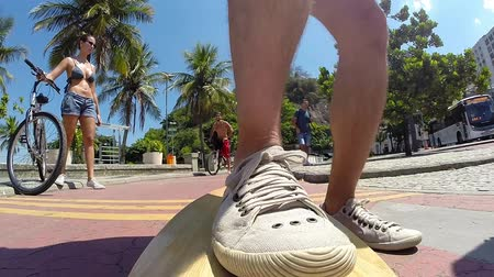 deskorolka : Skateboarder on Copacabana Beach in Rio de Janeiro. Camera in front of the skateboard. Wideo