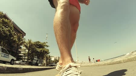deskorolka : Skateboarder on Copacabana Beach in Rio de Jaeiro (vintage look). Camera on top of the skateboard.