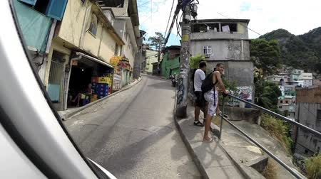 brezilya : Car driving on narrow steep hill streets in Brazilian favela (slum) , Rio de Janeiro.