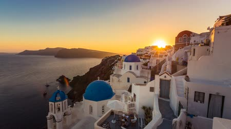 aegean sea : Sunset over beautiful town of Oia on the Island of Santorini, Greece Stock Footage