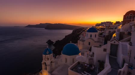 sunset sea : Sunset over beautiful town of Oia on the Island of Santorini, Greece Stock Footage