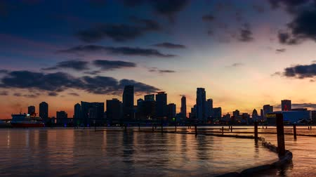Майами : Miami skyline at sunset with clouds passing by