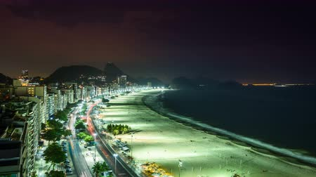 Рио : Copacabana Beach street traffic at night, Rio de Janeiro - Brazil. Pan and zoom Time Lapse Стоковые видеозаписи