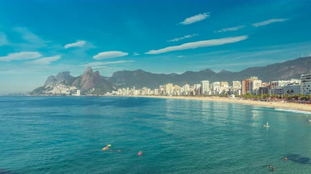 brezilya : Ipanema Beach panning time lapse with people swimming in the ocean. Rio De Janeiro, Brazil Stok Video