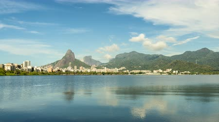 бразильский : Time Lapse of Rio De Janeiro iconic Mountains with reflection in water, Brazil. Стоковые видеозаписи