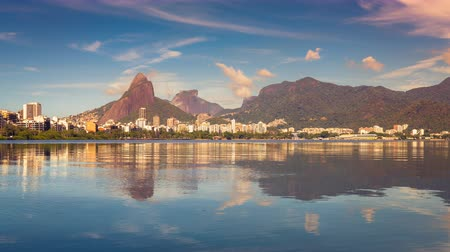 бразильский : Panning Time Lapse of Rio De Janeiro Mountains with reflection in water, Brazil. Vintage morning look. Стоковые видеозаписи