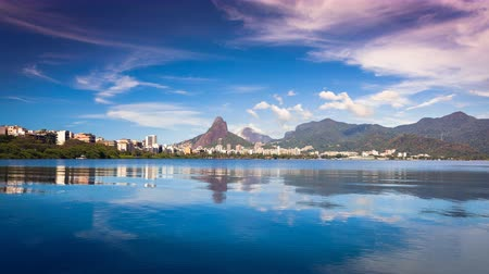 бразильский : Mountains with reflection in water and clouds dynamic panning Time Lapse, Rio De Janeiro, Brazil. Vintage morning look.