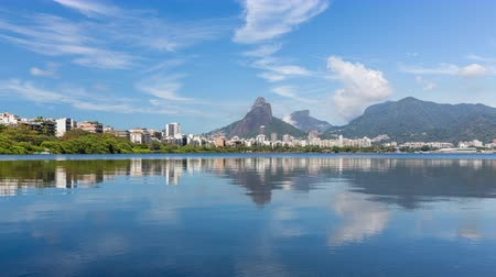 бразильский : Mountains with reflection in water and clouds dynamic panning Time Lapse, Rio De Janeiro, Brazil.