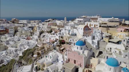 УВР : Close Aerial footage above iconic Blue Dome Churches on Santorini Island Greece.