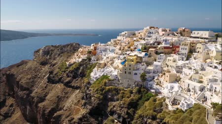 греческий : Aerial footage with pan above Santorini Island with iconic white and blue buildings in Greece.