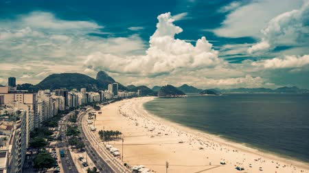 brazília : Copacabana Beach high angle street Time Lapse in Rio de Janeiro Brazil. Clouds rolling dynamic with vintage colors.