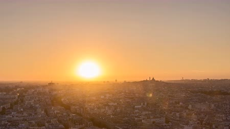 time journey : City of Paris sunrise with Sacre Coeur Basilica and Montmarte Hill, France. Time Lapse Shot