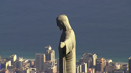 Рио : Aerial close up view of Christ Statue and building on the Beach, Rio de Janeiro. Стоковые видеозаписи