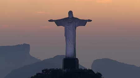 Рио : Aerial view of illuminated Christ the Redemeer Statue with Sunset Sky, Rio de Janeiro, Brazil.