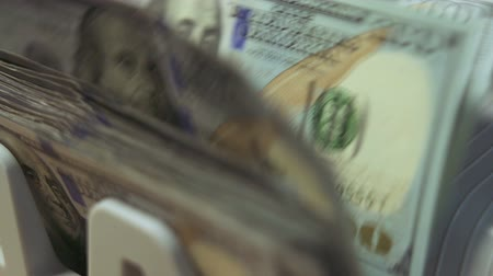 imposto : Cash counting machine counts 100 dollar bills. Close up dolly shot, shallow DOF Stock Footage