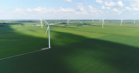 jídla : Wind farm on countryside field, agriculture industry