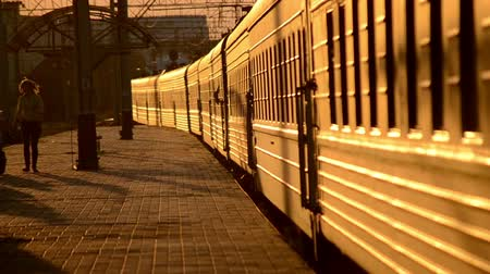 mourners : Train Station, Belaya Tserkov, Ukraine - July 31, 2015.The train with cars that are illuminated by the setting sun departs from the train station
