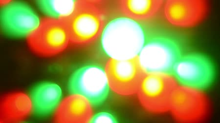 gömbölyű : Abstract background of blurry red and green lights of small lamps of a large moving