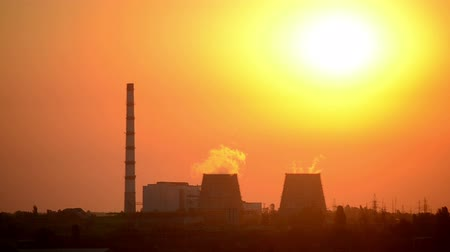chp : beautiful dark silhouette thermal power plant at sunrise, sunset