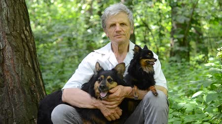 franzir : portrait old man with dogs in woods