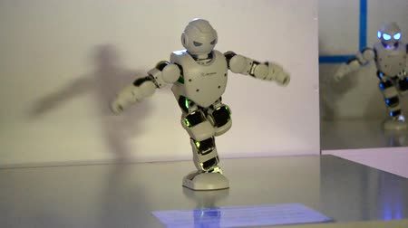 ludziki : Kiev, Ukraine - August 12, 2017: Small cyborg robots, humanoids with face, luminous eyes, body dances and makes different movement of hands, feet to music. Artificial Intelligence. AI. Smart robot.