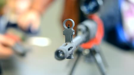 autorifle : Submachine Gun on the table close-up macro Stock Footage