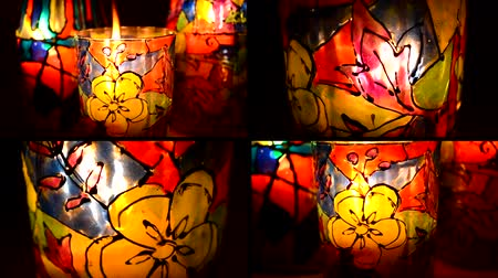 vítreo : 4 in 1. Candle flame shines in colorful candlestick closeup. Candle light through glass candlestick, painted with colorful design. Vídeos