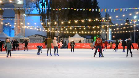 ice skating : Kiev, Ukraine, December 17, 2017: - Ice rink with many people outdoors open by night.
