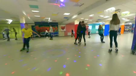 mtb : Bila Tserkva, Ukraine January 21, 2018: A Person roller-skating on the inside rollerdrom. Many people of children and adults go roller-skating on the indoors. Point of view, pov mtb. Low Angle View. Stock Footage