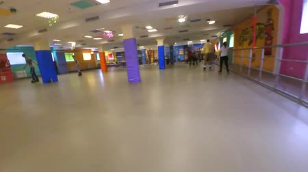 mtb : Bila Tserkva, Ukraine January 21, 2018: Fast. A Person roller-skating on inside rollerdrom. Many people of children and adults go roller-skating on the indoors. Point of view, pov mtb. Low Angle View.