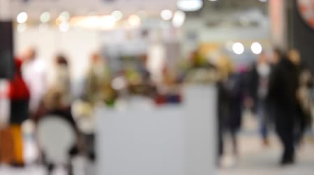 diffuse : Abstract Defocused Blurred Background flow of many people inside space shopping center or mall, exhibition, exposition, hall with red carpet real time. Stock Footage