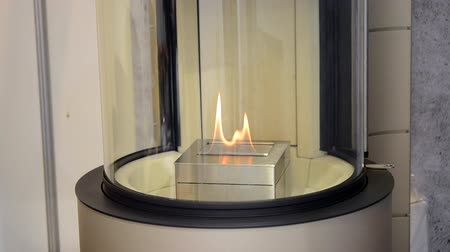 hearth : Modern bio fireplot fireplace on ethanol gas. Smart ecological alternative technologies. Contemporary biofuel on ethanol close-up. Energy saving innovation. Interior inside a house Stock Footage