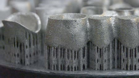 titanium : Object printed on metal 3d printer. Dental crowns created in a laser sintering machine close-up. DMLS, SLM, SLS technology. Concept of 4.0 industrial revolution. Progressive modern additive technology