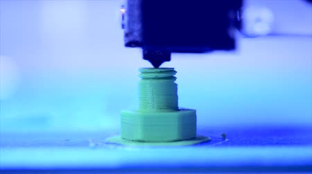 polymer : 3D printer working close up. Automatic three dimensional 3d printer performs plastic. Modern 3D printer printing an object from the hot molten. Concept progressive additive technology for 3d printing.