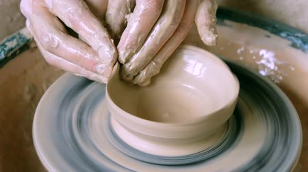 clay pot : Woman girl her hands dub wall jug, sculpts out of clay on circle. Workshop on sculpt white clay closeup. Dirty hands in the clay. Making ceramic products. Artistic creative. Craft.