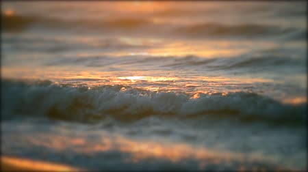 óceáni : Beautiful soft focus surface of sea ocean wave with rays of sun at sunset dawn sunrise close-up. Concept rest relax summer recreation vacation holiday. Natural sea marine oceanic background backdrop