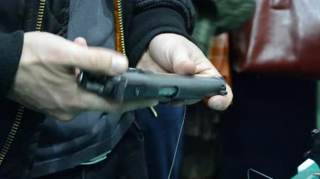калибр : Person holding a gun in hand close-up.