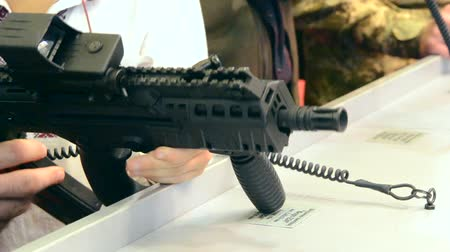 defending : Firearms gun submachine sniper rifle large-caliber weapons close-up.