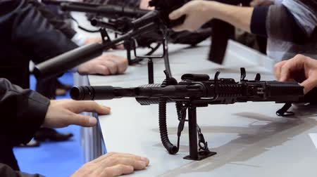 autorifle : Several large-caliber weapons on the table. Firearms gun submachine sniper rifle close-up. Stock Footage