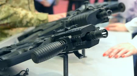 калибр : Several large-caliber weapons on the table. Firearms gun submachine sniper rifle close-up. Стоковые видеозаписи