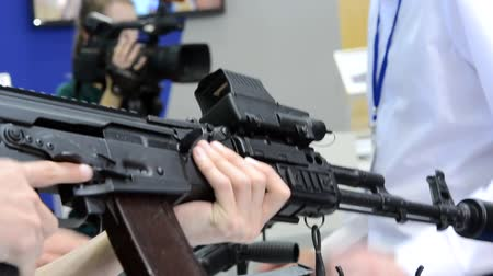 armado : Submachine Gun on the table close-up. Several large-caliber weapons on the table. Firearms gun submachine sniper rifle close-up.