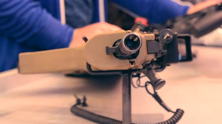 autorifle : Weapon optics sight of sniper rifle with man close-up in store or shop. Firearms gun submachine sniper rifle large-caliber weapons close-up.