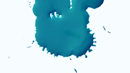 cákanec : Blue ink abstract stains flow on a white surface. Blue ink spot spreads Blue ink spot spreads on background isolated close-up
