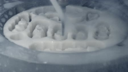 protetyka : Automatic Process Dental Milling Machine Carving Out the Exact Shape Model of Human Teeth in a Dental Lab Close-up. Processing of carving out shape of human teeth from dental milling machine. Wideo
