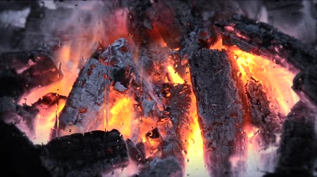 febre : burning up the black and red embers fire flame close up. Rain raindrops, dripping rain drops on the glass, gray cloudy weather rainy Stock Footage